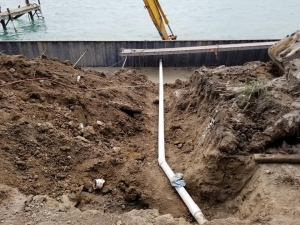 Down Spout Drain Going Threw 120' Seawall Install of 17' 5Gauge FNC Steel Sheet Piling.