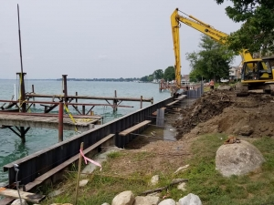 Capping Of The 120' Seawall Install of 17' 5Gauge FNC Steel Sheet Piling before back filling.